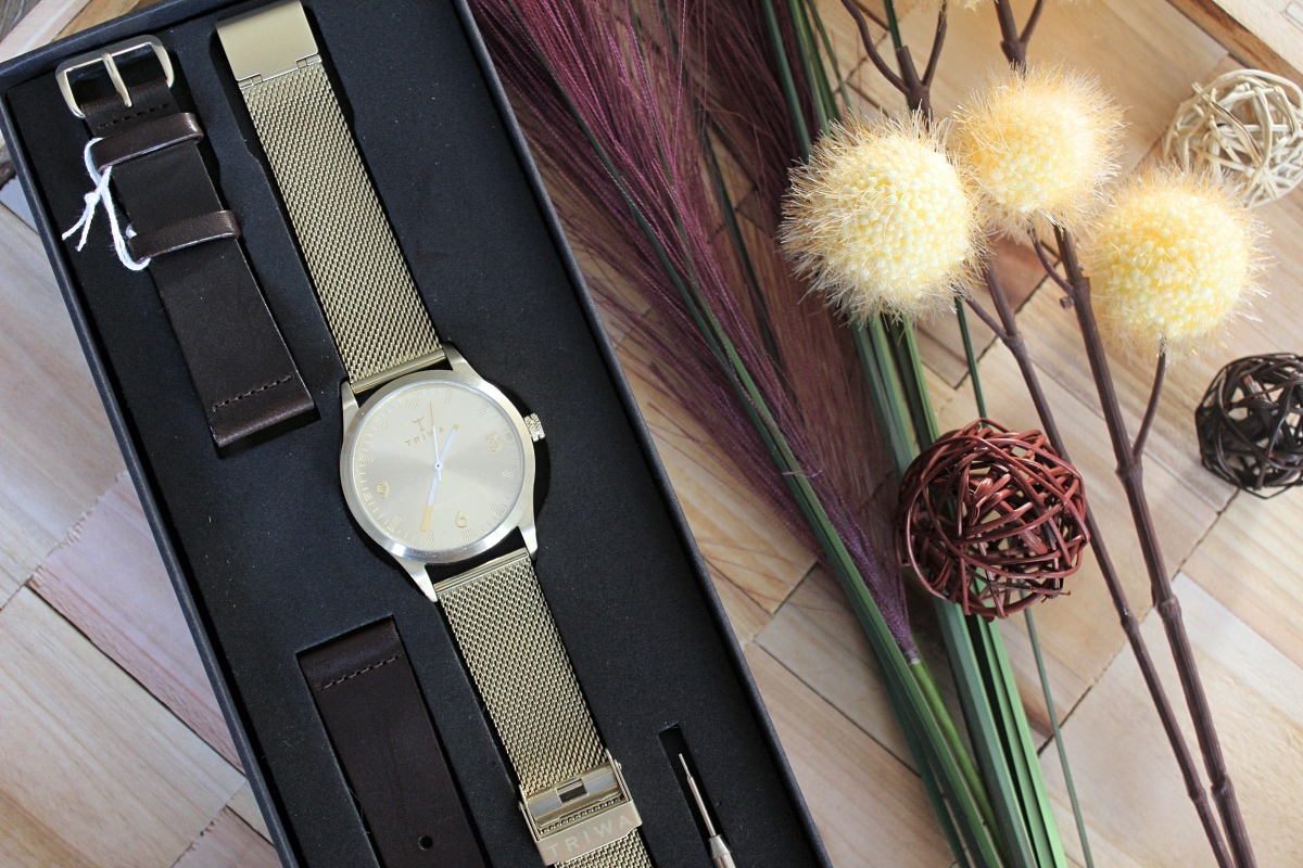 sort of black triwa gold watch